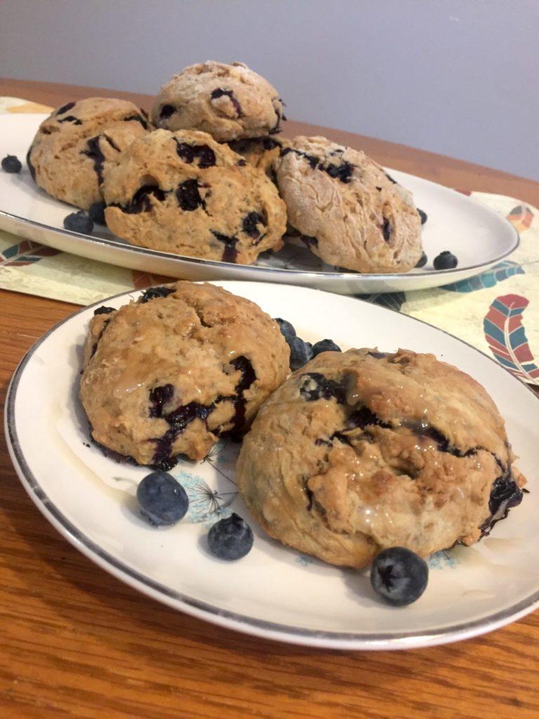 closeup photo of vegan lemon blueberry scones with lemon glaze